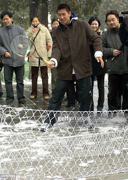 Thai tennis sensation Paradorn Srichaphan tries his skills at miniature tennis during a visit to the Temple of Heaven in Beijing 26 November 2003...