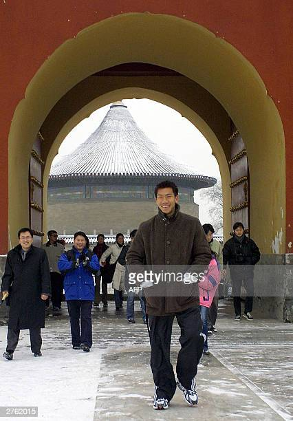 Thai tennis sensation Paradorn Srichaphan walks about during a visit to the Temple of Heaven in Beijing 26 November 2003 Both Paradorn and Russia's...