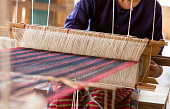Thai traditional Weaving work and equipment with woven yarn in the background