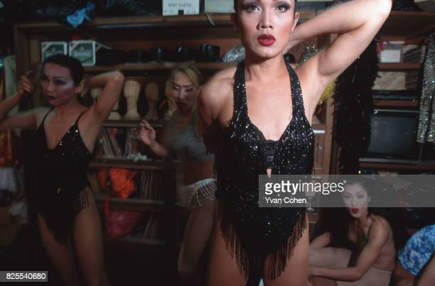 Thai transsexual performer adjusts her costume before going onstage for a show at a nightclub in Bangkok Transsexuals or Katoeys as the Thais call...