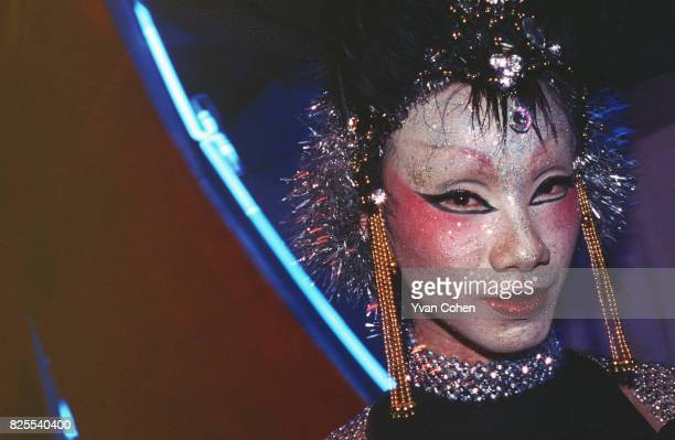 Thai transsexual poses for the camera before going onstage for a beauty contest a club in Bangkok Transsexuals or Katoeys as the Thais call them are...