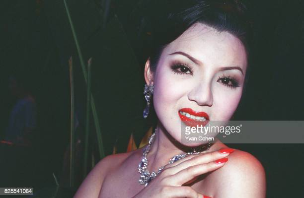 Thai transsexual poses for the camera before going onstage for a beauty contest in a club in Bangkok Transsexuals or Katoeys as the Thais call them...
