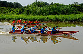 Thai villagers take part in a boat race on the Yakang river during celebrations of the Eid alFitr festival in Thailand's southern province of...