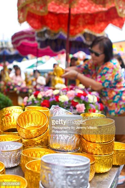 Thai Water Bowls, Buddha Bathing Ceremony in Wat Pho, Bangkok, Thailand