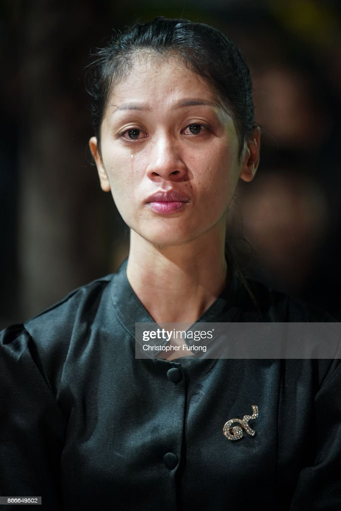 A Thai woman grieves as she watches a video screen showing the funeral of the late Thai King Bhumibol Adulyadej on October 26, 2017 in Bangkok, Thailand. Tens of thousands of people, dressed in black , have gathered in Bangkok over a year after the death of Thailand's popular King Bhumibol Adulyadej. The five-day royal cremation ceremony is taking place between October 25-29 in Bangkok's historic Grand Palace and the Sanam Luang area.