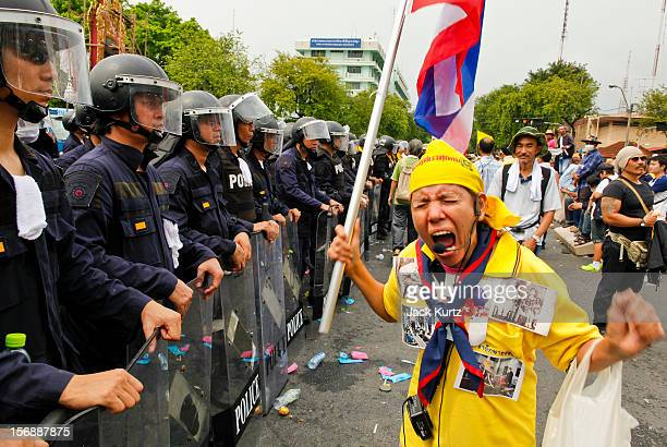 Thai woman professes her love for Bhumibol Adulyadej the King of Thailand in front of riot police during a large anti government protest on November...
