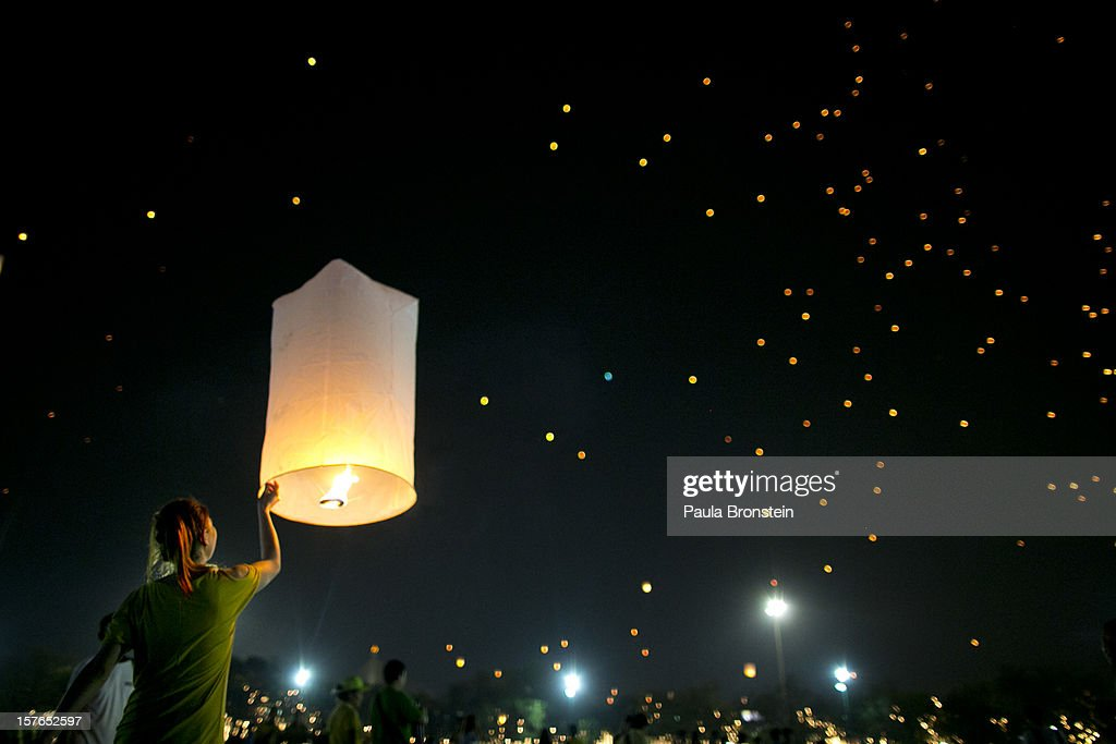A Thai woman releases a lantern to the night sky during celebrations to pay respect to Thailand's King Bhumibol Adulyadej on his 85th birthday December 5, 2012 in Bangkok, Thailand. King Bhumibol took the throne in 1946, making him the world's longest reigning monarch and the world's longest serving head of state. Yellow represents Monday, the birthday of the King.