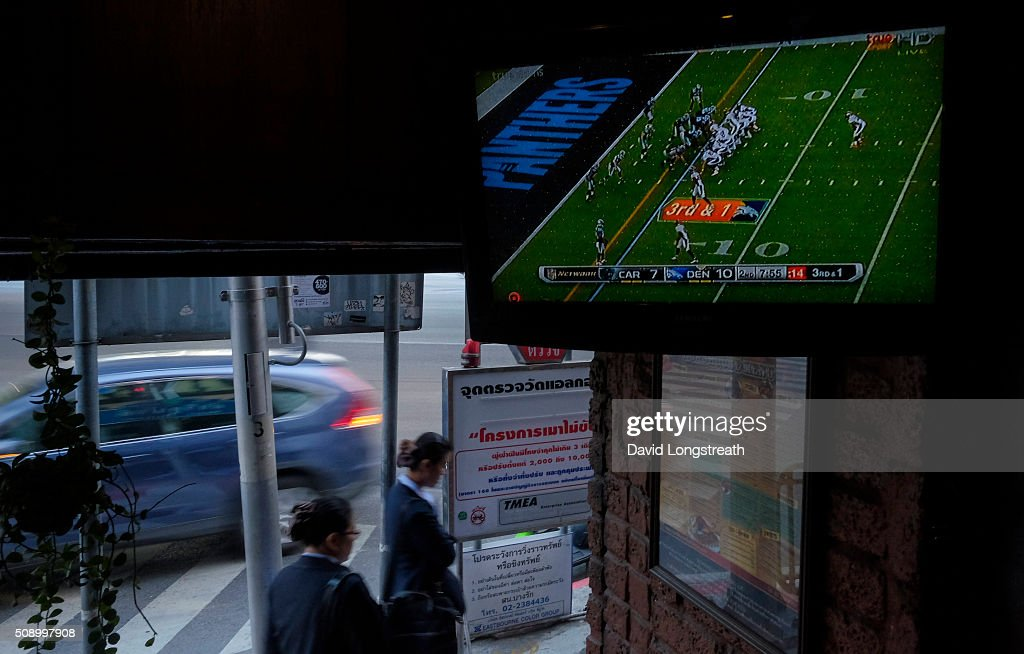 Thai women make their was past a pub where ex-patriots and others gathered to watch Superbowl 50. The Denver Broncos defeated the Carolina Panthers 16-10 to win the football championship. The game was played in San Francisco and championship has been a part of American history since 1967.