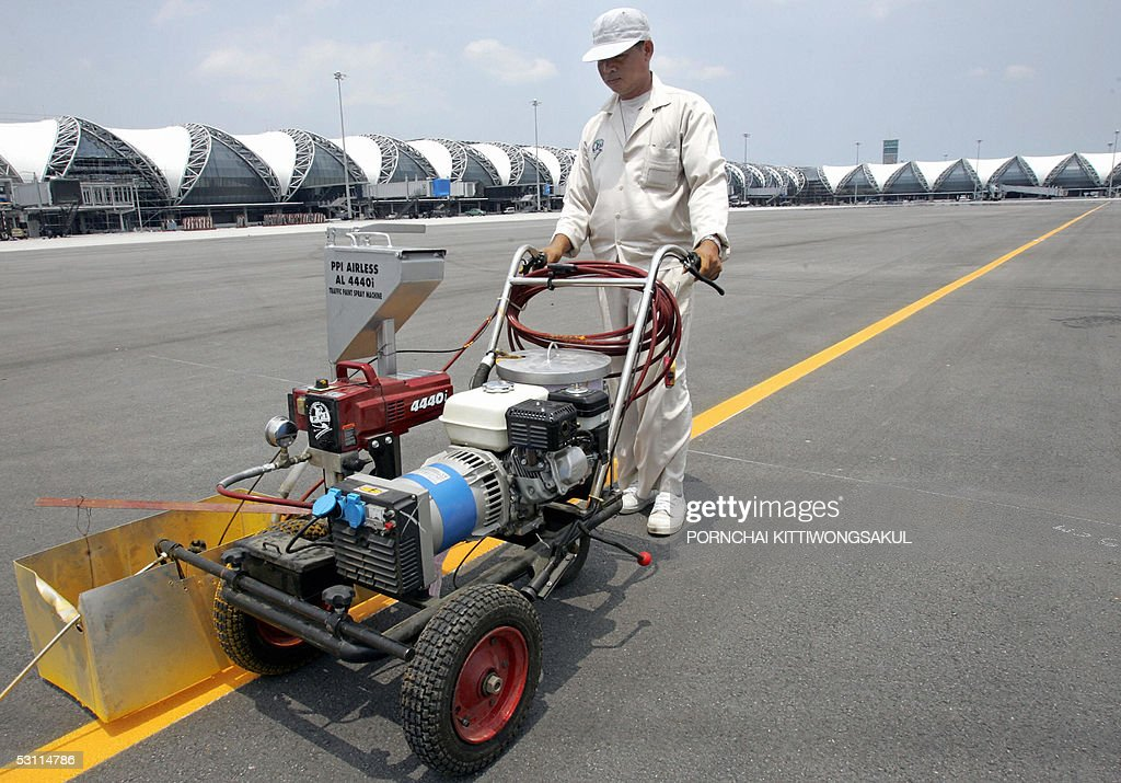 Thai worker marks the tarmac of Bangkok's new Suvarnabhumi international airport in suburb Bangkok 22 June 2005 The opening of Bangkok's new...