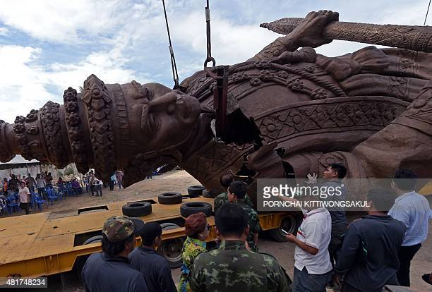 Thai workers and soldiers prepare a statue of King Narai of Ayutthaya for transport from a casting factory in Lopburi province on July 24 2015 The...