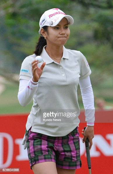 PATTAYA Thailand Ai Miyazato of Japan acknowledges fans in the gallery at the Siam Country Club in Thailand after holing out in the first round of...