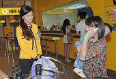 BANGKOK Thailand An employee of Nok Air a Thai budget airline explains to passengers the airline has been forced to suspend operations for safety...