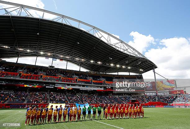 Thailand and Germany stand prior to their FIFA Women's World Cup Canada 2015 match at Winnipeg Stadium on June 15 2015 in Winnipeg Canada