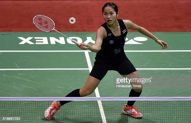 Thailand Badminton player Ratchanok Intanon in action against Chinese Badminton player Li Xuerui at women's final match during the YonexSunrise India...