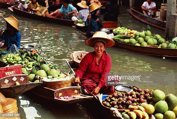 Thailand, Bangkok, fruit trader in Bang Khu Wiang floating market