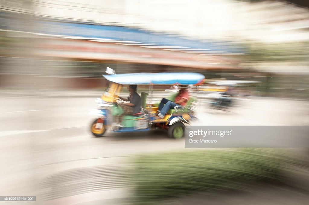 Thailand, Bangkok, Tuk Tuk rickshaw (blurred motion)  : Stock Photo