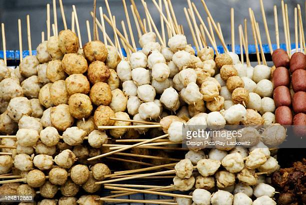 Thailand, Bangkok, unusual delicacies found at street vendor food stalls, skewers of a variety of different meatballs.