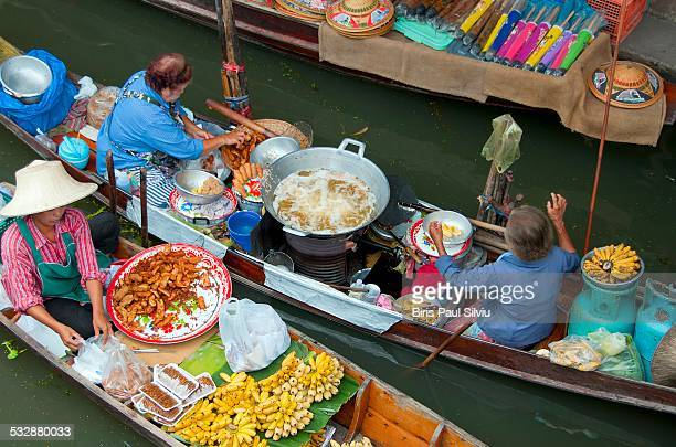 Thailand Bangkok Vendors in boats at floating market Damnoen Saduak near Bangkok