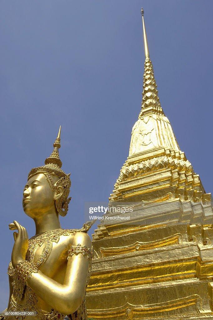 Thailand, Bangkok, Wat Phra Kaeo, golden Kinaree statue at Royal Palace : Stock Photo