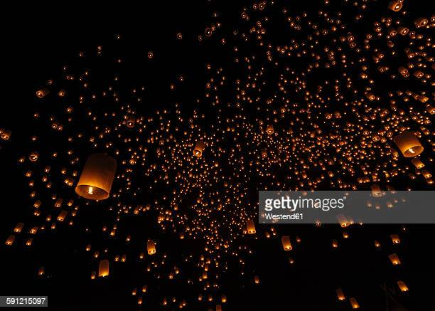 Thailand, Chiang Mai, lighted lanterns at night at Yee Peng Festival