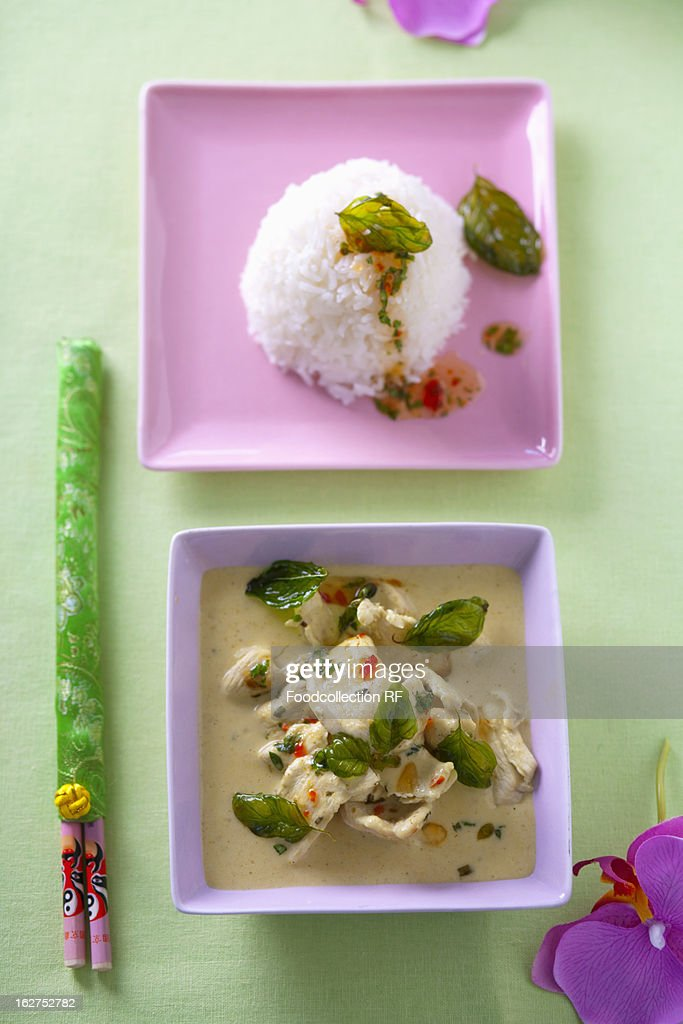 Thailand, Chicken ragout with chillies and basil and plate of rice : Stock Photo