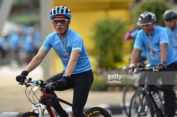 Thailand Crown Prince Maha Vajiralongkorn cycles during the cycling event 'Bike for Mom' at the Victory Monument in Bangkok Thailand on August 16...
