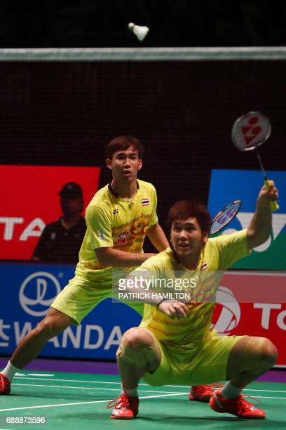 Thailand Dechapol Puavaranukroh and Bodin Issara hit a return during the men's doubles Sudirman Cup match against Seung Jae Seo and Choi Solgyu of...