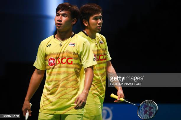 Thailand Dechapol Puavaranukroh and Bodin Issara react during the men's doubles Sudirman Cup match against Seung Jae Seo and Choi Solgyu of South...