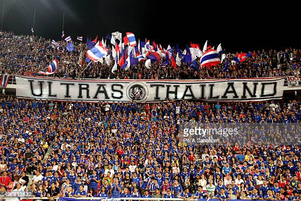 Thailand football fans cheers during 2018 World Cup qualifying soccer match against Taiwan at Rajamangala National Stadium in Bangkok Thailand beat...