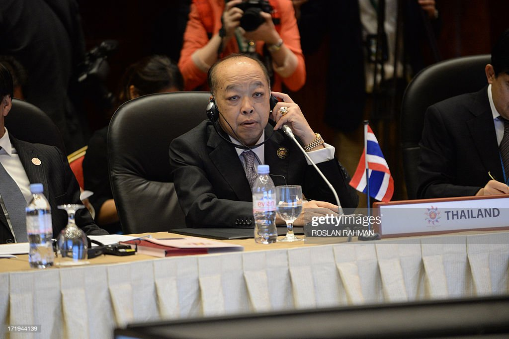 Thailand Foreign Minister Surapong Tovichakchaikul listens at the annual 10-member Association of Southeast Asian Nations (ASEAN) foreign ministers' meeting in Brunei's capital Bandar Seri Begawan on June 30, 2013. Southeast Asia's top diplomats kicked off a major regional forum on June 30 with a firm focus on trying to ease tensions with China over a territorial row, amid warnings that failure could lead to conflict.