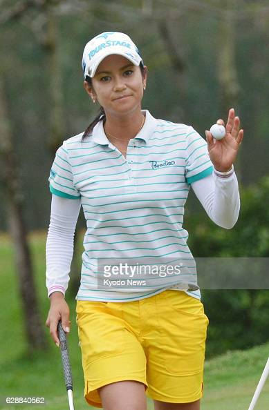 PATTAYA Thailand Japan's Ai Miyazato acknowledges cheers from the gallery after completing her second round of the Honda LPGA golf tournament at Siam...