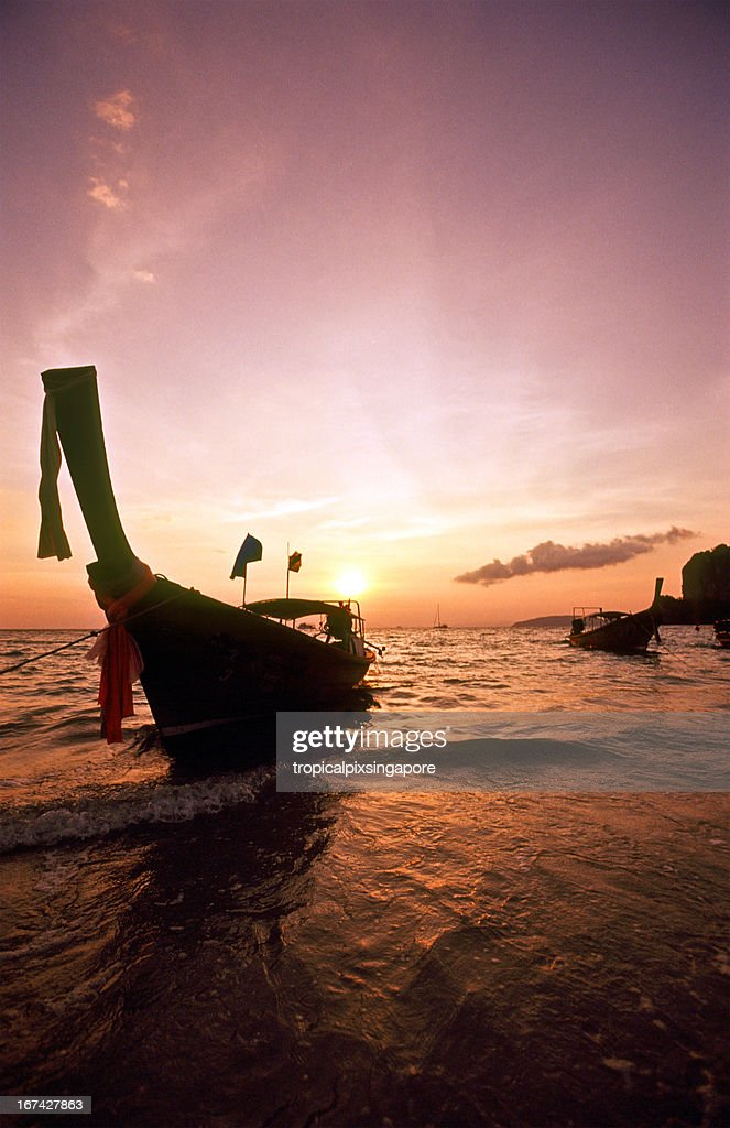Thailand, Krabi Province, Railay West, longtail boats, sunset. : Stock Photo