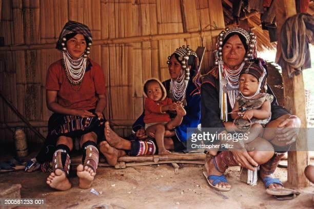 Thailand, Mhahinkong, Akha tribal village, prostitutes outside hut