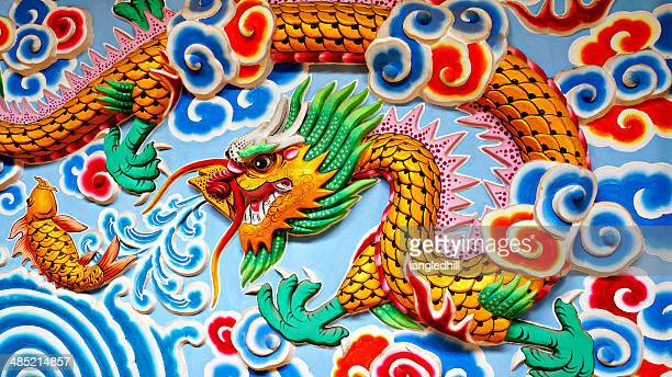 Thailand, North East, Wall art of Chinese water dragon and fish
