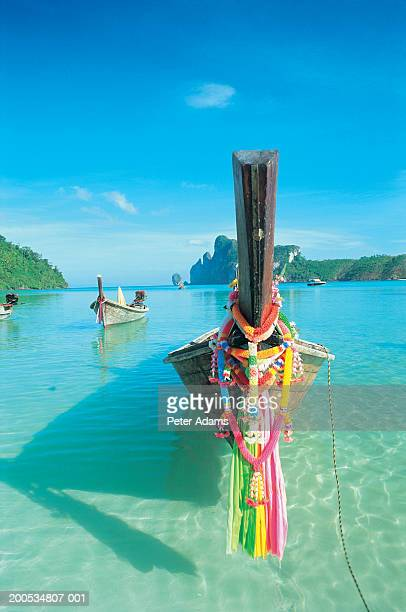 Thailand, Phi Phi Islands, ribbons tied to longtail boat in bay