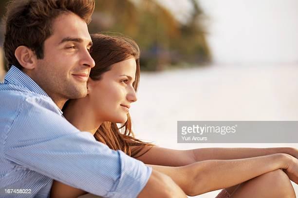 Thailand, Portrait of couple hugging on beach