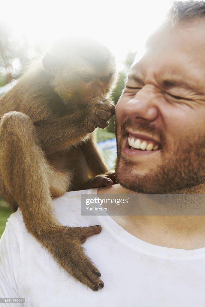 Thailand, Portrait of man holding monkey