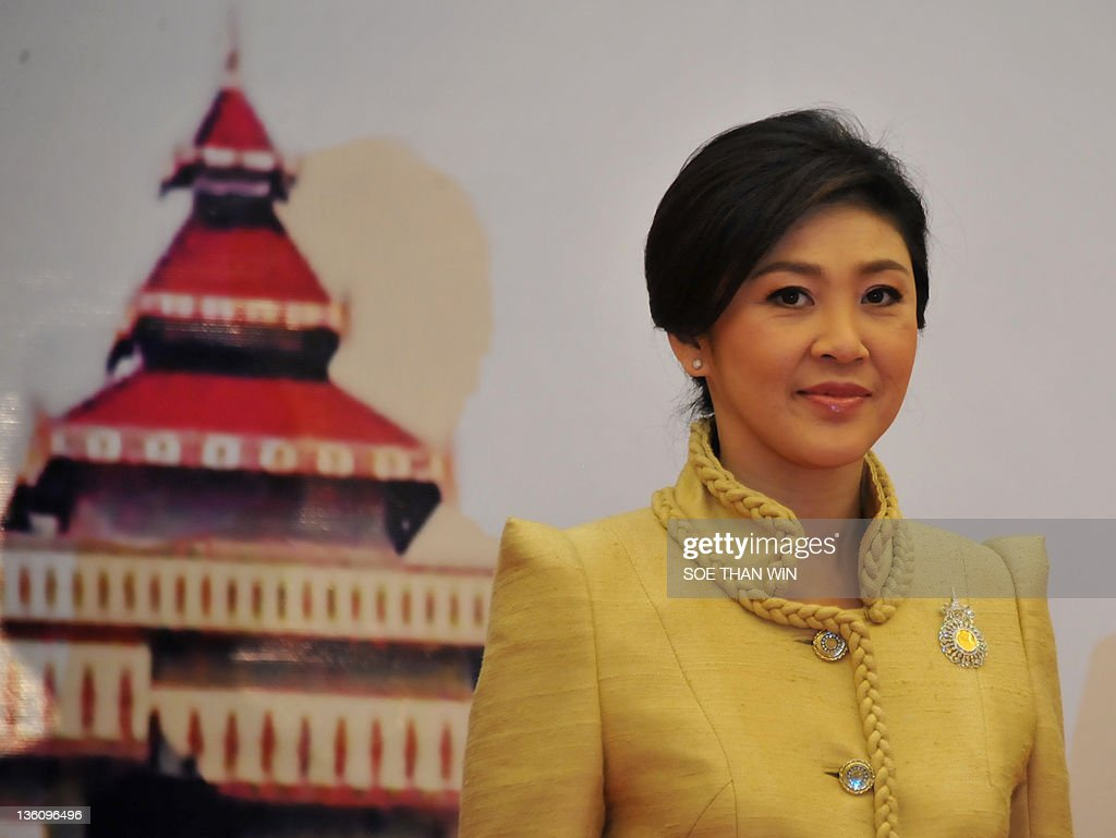 Thailand Prime Minister Yingluck Shinawatra poses for photo before a Gala dinner during the 4th Greater Mekong Subregion (GMS) Summit in Myanmar's capital Naypyidaw on December 19, 2011. AFP PHOTO Soe Than Win