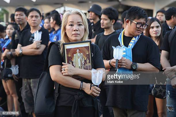 Thailand supporter poses holding a framed image of King Bhumibol Adulyadej before the 2018 FIFA World Cup Qualifier match between Thailand and the...