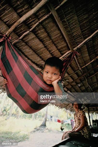 Thailand, Surat Thani, Ko Pha Ngan, local boy in hammock