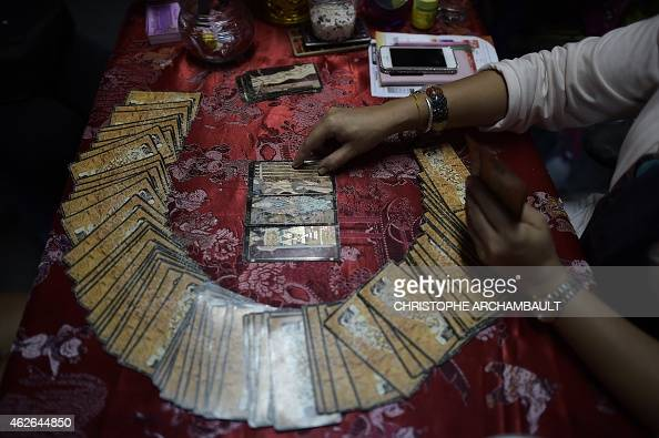 ThailandlifestyleculturereligionFEATURE by Delphine THOUVENOT Thanaporn PROMYAMYAI This picture taken on January 15 2015 shows a fortune teller using...