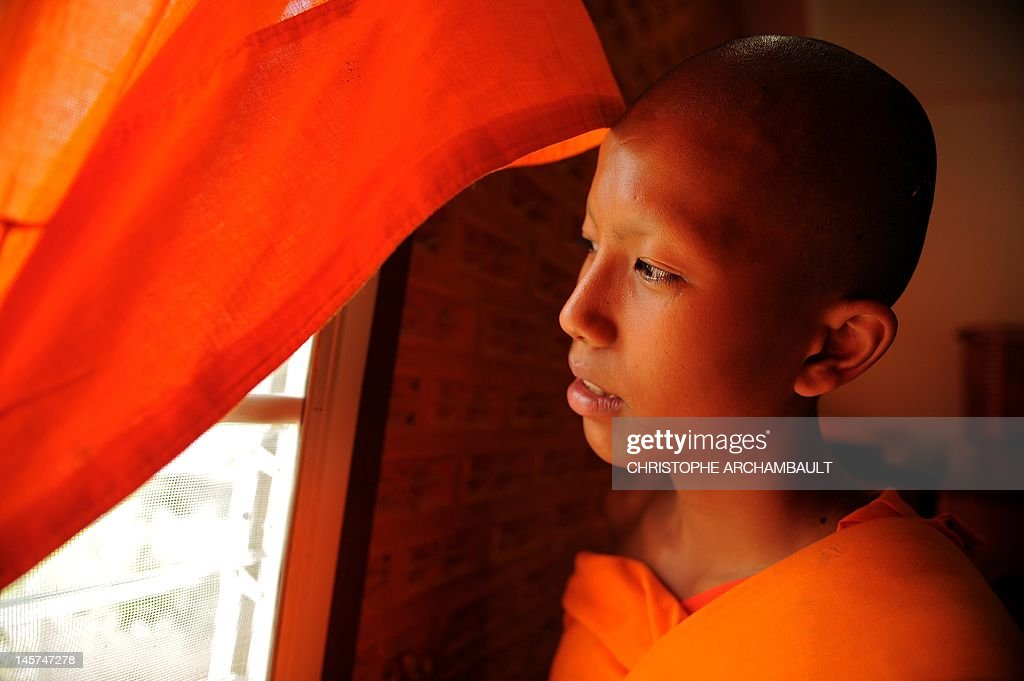 STORY 'Thailand-religion-society-gender' by Janesara FUGAL This picture taken on June 16, 2011 shows Buddhist novice monk and aspiring ladyboy Pipop Thanajindawong looking outside from his room at the Wat Kreung Tai temple, in Thailand's northern border town of Chiang Khong. The Kreung Tai temple has run a course to teach masculinity to boys who are 'katoeys', the Thai term for transsexuals or ladyboys, aged between 11 and 18 since 2008. AFP PHOTO/Christophe ARCHAMBAULT