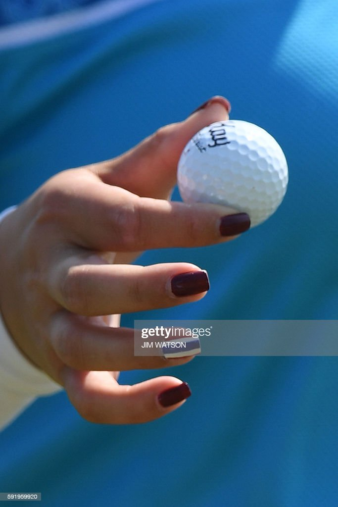 Thailand's Ariya Jutanugarn painted nails are seen in the Women's individual stroke play at the Olympic Golf course during the Rio 2016 Olympic Games...