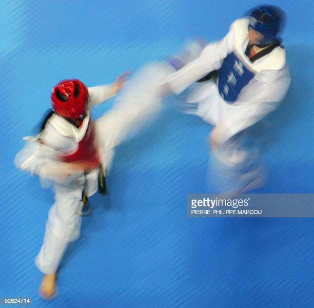 Thailand's Chonnapas Preanwaew fights against Ireland's Catherine Sheridan during their women's under 63 kg preliminary match at the Taekwondo World...