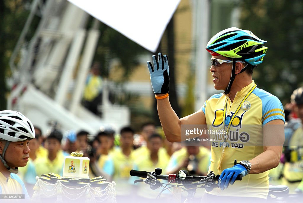 Thailand's Crown Prince Maha Vajiralongkorn waves to the crowd as he cycles in the 'Bike for Dad' event in Bangkok. Thai Crown Prince Maha Vajiralongkorn led thousands of cyclists on a 29-km course in Bangkok to celebrate King Bhumibol Adulyadej's 88th birthday.