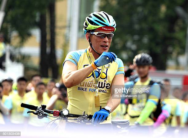 Thailand's Crown Prince Maha Vajiralongkorn waves to the crowd as he cycles in the 'Bike for Dad' event in Bangkok Thai Crown Prince Maha...