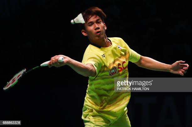 Thailand's Dechapol Puavaranukroh hits a return with partner Sapsiree Taerattanachai during the mixed doubles Sudirman Cup match against Chae Yoo...