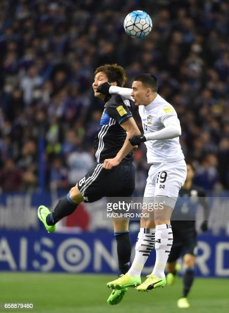 Thailand's defender Tristan Do hits the face of Japan's forward Genki Haraguchi during group B World Cup 2018 qualifying football match between Japan...
