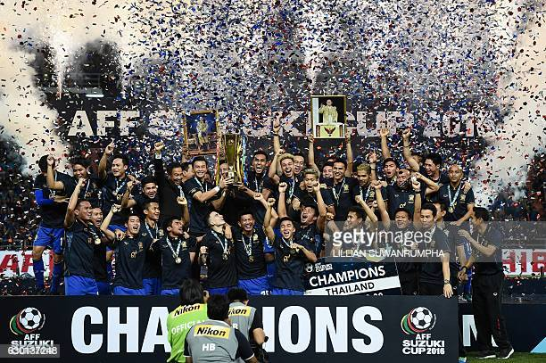 TOPSHOT Thailand's football players lift the AFF Suzuki Cup after winning the second leg of the final between Thailand and Indonesia 20 at...