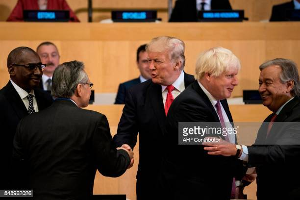 Thailand's Foreign Minister Don Pramudwinai and US President Donald Trump shake hands while British Foreign Secretary Boris Johnson and UN...
